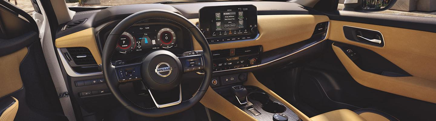 Driver's side view of a Nissan Rogue's steering wheel and touchscreen display