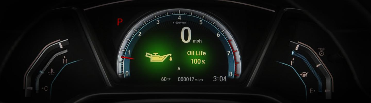 A dash displaying a oil change service light