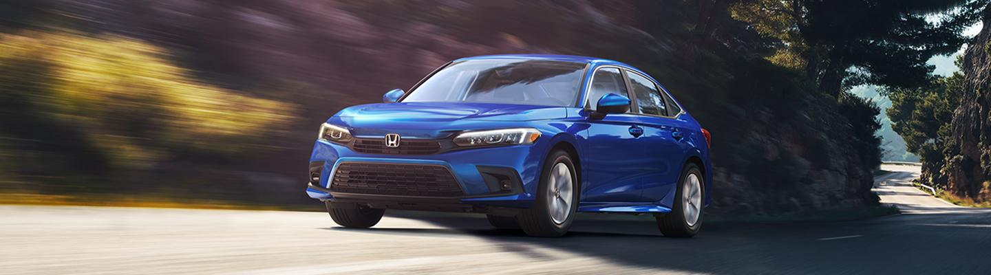 Front view of a blue 2022 Honda Civic in motion