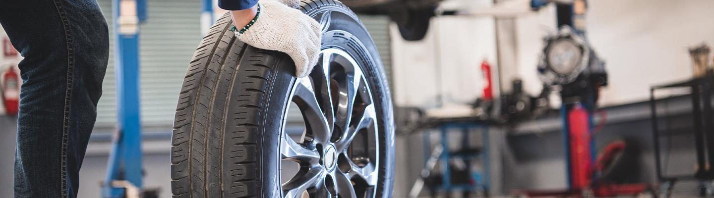 Service tech changing a tire