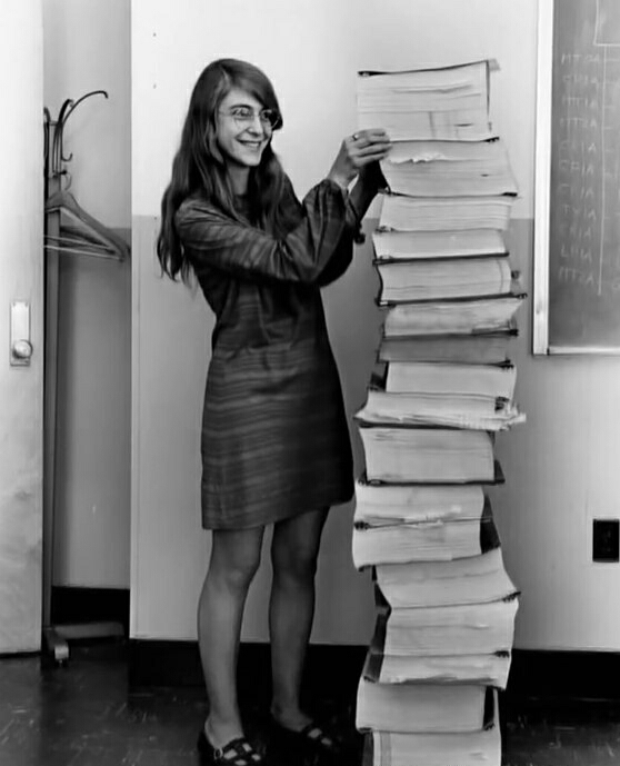 Margaret Heafield Hamilton besides her work (a lot of printed books with code from the Apollo 11 mission)