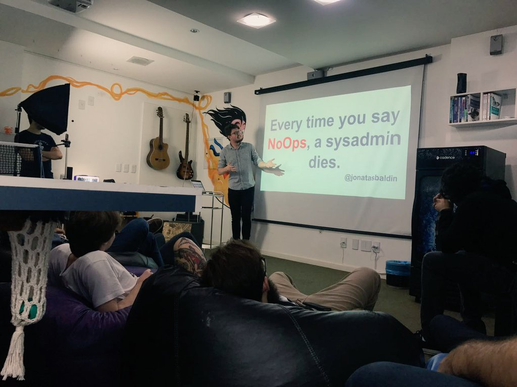The author presenting a slide, which has written: Every time you say NoOps, a sysadmin dies.
