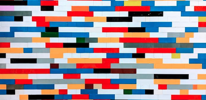 A wall of colorful bricks like Lego.