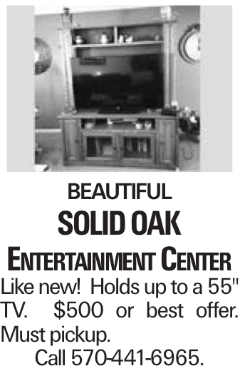 """Beautiful solid oak Entertainment Center Like new! Holds up to a 55"""" TV. $500 or best offer. Must pickup. Call 570-441-6965."""