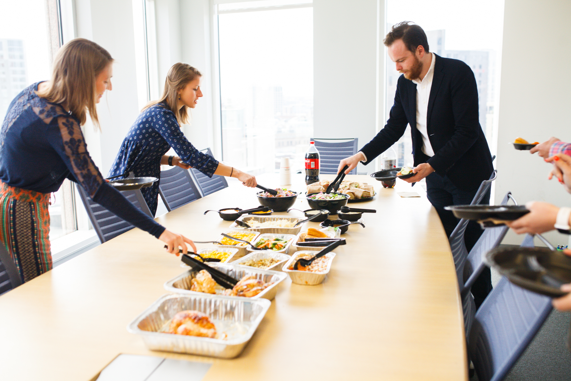 """As Thanksgiving and Christmas office parties inch ever closer, Boston Market is ready to help with holiday catering. """"The holiday season is kind of our Super Bowl if you will,"""" says Maria Strickland of Boston Market. Strickland is the director of catering sales support at Boston Market and has been with the chain for 11 years. Her team is already reaching out to regular catering customers to assist them in menu planning. They'll begin collaborating with customers on festive holiday spreads, too. These accommodations are all done with ease because Boston Market keeps customer notes on file like head counts, delivery arrangements, and any special catering menus customers may have requested in the past. Their goal is to make catering as easy as possible. For more than three decades, Boston Market has made holiday meals incredibly easy with their catering. With over 450 locations nationwide, the chain became famous for rotisserie chicken and other comfort food classics when Steven Kolow and Arthur Cores founded it in Massachusetts back in 1985. More than three decades later, Boston Market is still a dependable caterer, especially as the holidays arrive. """"We've been around so long because of the quality of our food,"""" explains Strickland. """"It's what people wish they had time to cook."""" At this time of year, the chain focuses on seasonal holiday favorites. Boston Market can be relied on to deliver classics like freshly roasted turkey and meatloaf. Their seasonal menus also revolve around festive sides like classic mashed potatoes and gravy, savory stuffing, and sweet corn. Their toasted marshmallow-topped sweet potato casserole, gooey macaroni and cheese, and tender green beans tossed in warm garlic butter bring to mind the sort of fare an American family might dine on at home. """"It all ties into what people grew up with, and what they remember eating at their grandmother's house, their parents' house, or whatever traditions that they have,"""" Maria Strickland says. While Bost"""