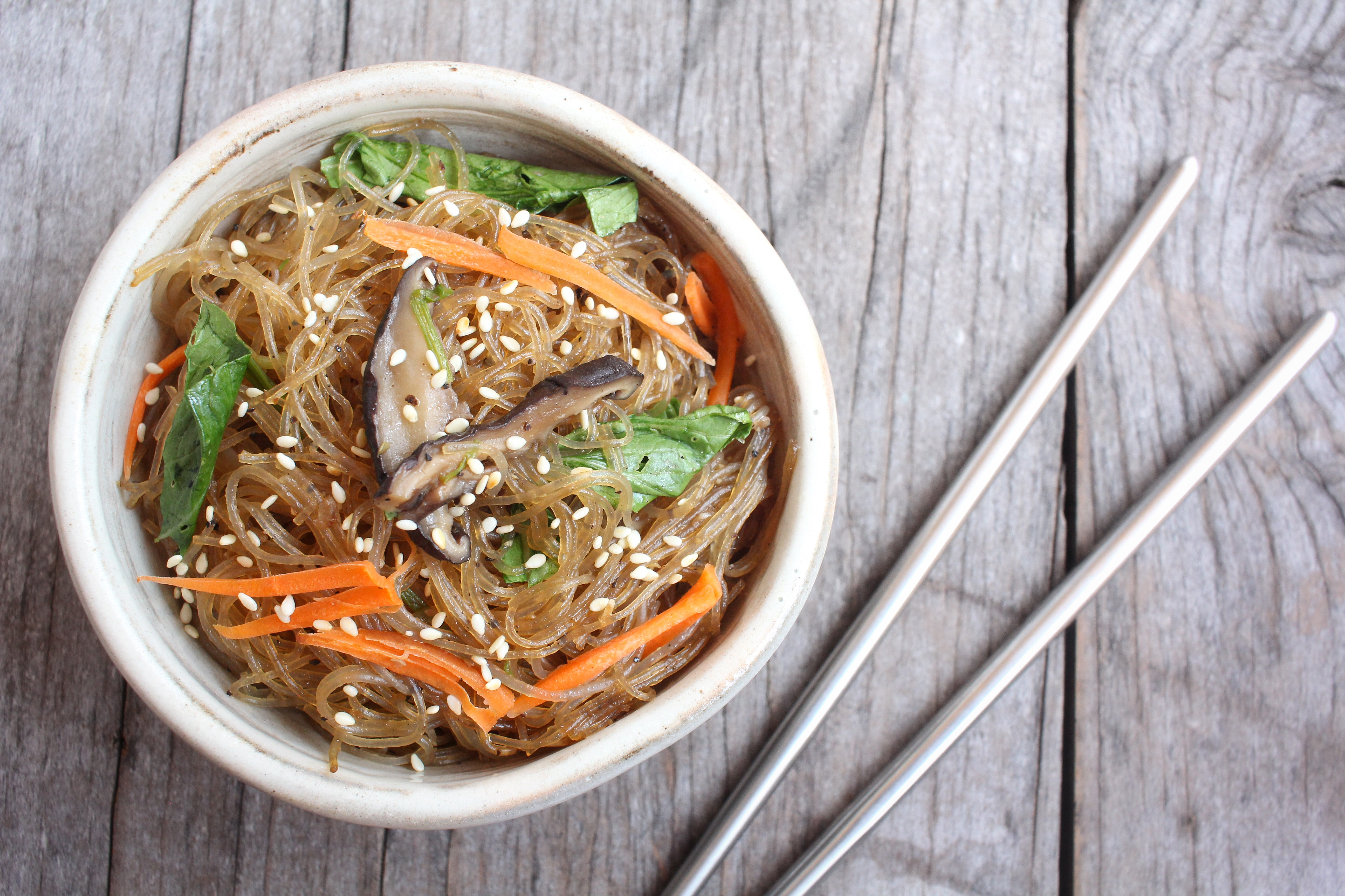Bookmark this list of Korean catering ideas so you remember to order foods like this one, glass noodles.