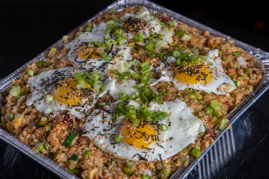 Your coworkers are sure to enjoy a catering tray of Korean fried rice, stir-fried with foods like beef and veggies.