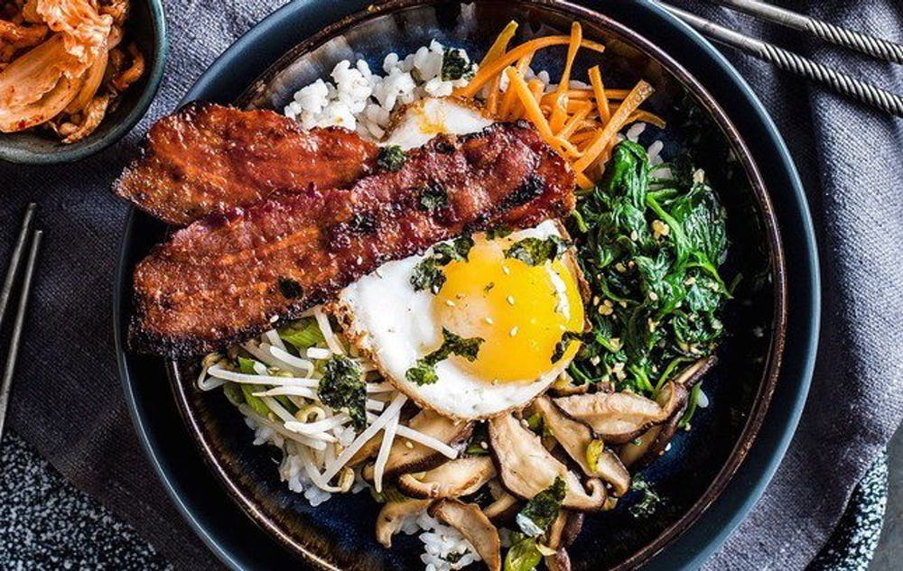 If you're looking for filling catering ideas, consider ordering bibimbap, one of the most famous foods of Korean cuisine.