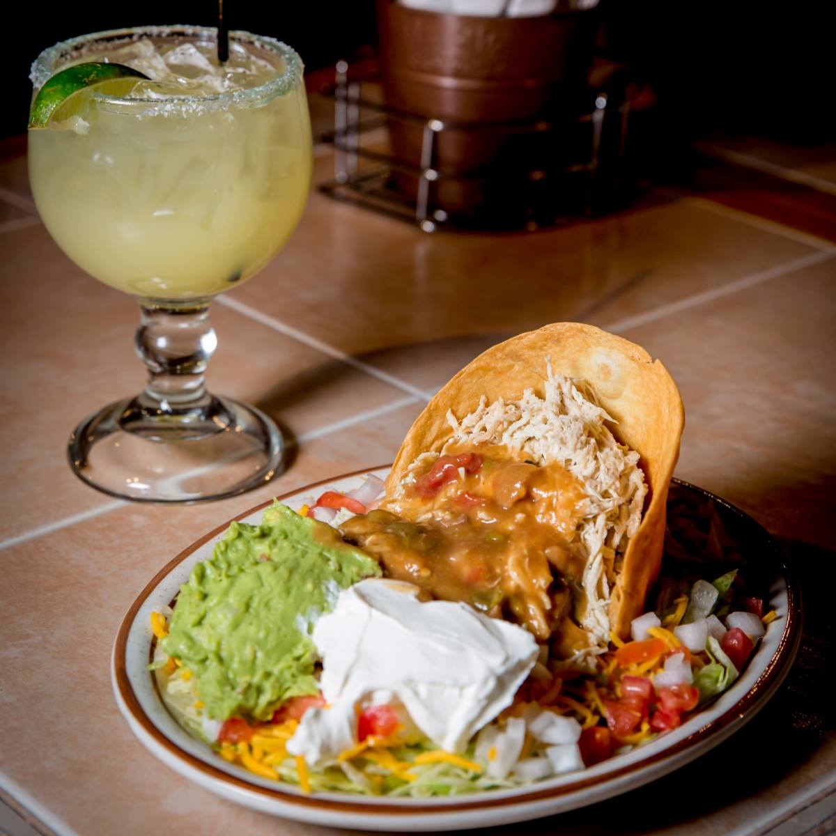 Whether your office is craving burritos or Mexican-style burgers, here are ten restaurants that will bring the best Mexican food in Denver straight to you.
