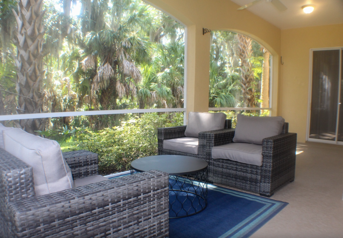 Beautiful Bradenton vacation rental property with palm trees and chairs