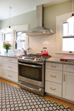 White shaker cabinets blends function and style reviving old historic Craftsman home.