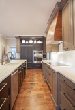 Mixing finishes is a great way to add interest to your kitchen design ideas.