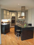 Modern kitchen with black granite and high gloss white cabinets.