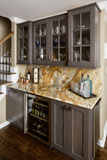 This small bar has room for beverage refrigerator, ice maker and decorative storage above.
