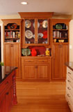 Cherry hutch adds pantry storage as well as beautiful display area.