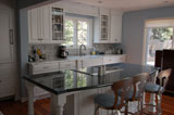 Traditional white kitchen with raised panel cabinetry.