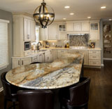 Painted cabinets, impressive granite, and interesting backsplash complete this transitional kitchen.