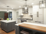 This kitchen design idea includes integrated and high end stainless appliances.