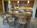 Traditional kitchen idea includes large island with seating for three.