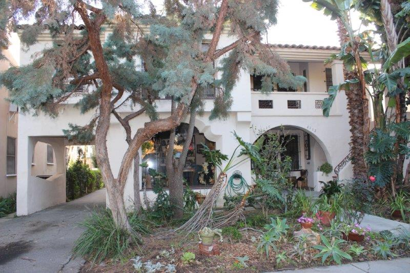 Classic Spanish Revival Duplex in Beverly Grove. 3 Bedroom 1.75 Bath each unit. The Porte-cochère above the driveway creates an extra room for the upstairs unit that could be a wonderful playroom or home office. The old world character and charm have not been destroyed: original wooden floors, fireplaces, quaint phone alcoves, arched and scalloped entry ways and scalloped lower living room window. Attention to detail iron work on the exterior and lots of original tile work in the kitchen and bathrooms. Five car garage and good sized grassy side yard. Located near the Grove, Whole Foods, LACMA, Cedars Sinai MC, Hancock Park Elementary School, Beverly Hills, WeHo and many of the trendiest restaurants in town.