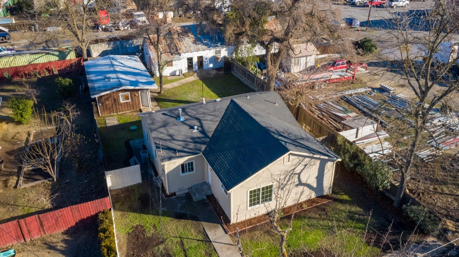 Investment/Rental or Multi-Generational Opportunity Awaits! Main Home with 3 Bed + Den / 2 Bath & Indoor Laundry. Guest House with 2 Bed / 1 Bath & oversized Metal Shop with 3 storage areas including 12' commercial overhead door & electrical throughout! Separate utility meters and entrances from Lurline or Palm. Fully fenced with tons of parking. Newer siding, windows, roof/gutters, irrigation, paint & carpet. Very well maintained and a must see! | gzE7ARR0rUU