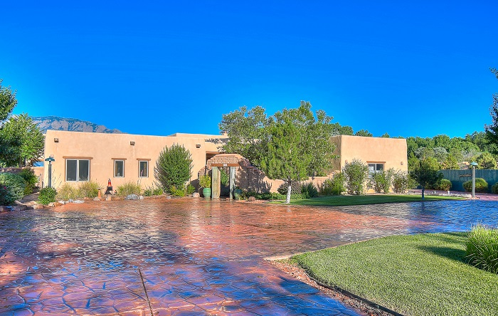 Grande Open House Sat July 20th, 1-3pm. Gracious Corrales Santa Fe Style Hacienda meticulously cared for, move-in ready. Checks all the boxes! Huge Mountain views, private end of cul de sac, high quality Pella wood windows, enchanting front courtyard, hand plastered walls, barrel ceilings, vigas & tongue & groove ceilings, 3 custom Kiva fireplaces w/ gas lighters, Wormy Maple cabinetry, sunlit, radiant heat floors, opulent owner's suite; corner kiva, walk in closet, steam shower, whirlpool view tub. Gourmet Sunrise Kitchen, Kiva, walk-in pantry. All ensuite bedrooms. Outdoor Portales. Expansive great room Casita with spa-like bath & additional studio wing. Oversized finished 4+ car garages inc 1-1/2 car collector or studio space. 400 Amp Service. Mature trees & landscape, fully fenced.