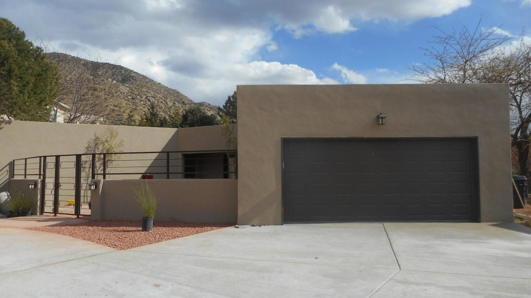 Remodeled in 2015, this Glenwood Hills single level home has amazing views of the Sandia foothills and an in ground private pool.