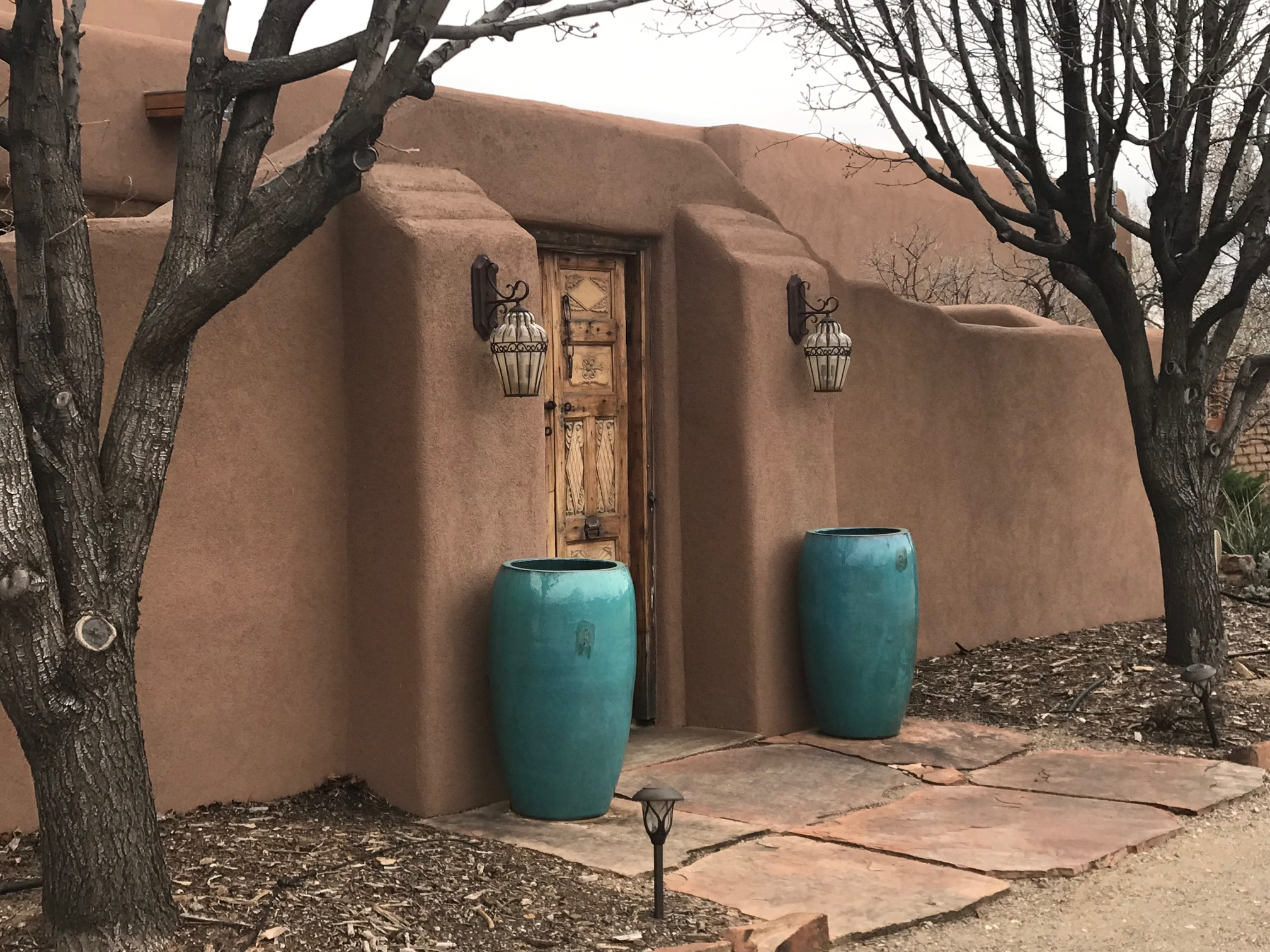 Open House Sat, Mar 23,1-3pm. South End Corrales, Character laden Santa Fe Style New Mexican Casa..high beamed ceilings, brick floors, light flooded row of French doors, corbels, hand carved doors, lighted nichos, adobe wall, antique gates, doors, vanities, diamond plaster two way kiva fireplace. Gourmet kitchen, 6 burner Wolf stove, pot filler, 4 seat breakfast bar, adjoining herb garden. Owner's Suite, kiva fireplace, 2 walk-in closets. 3 bedrooms with potential for 4th bedroom, office & large studio. Expansive East Courtyard is a verdant oasis of flowers, trees & bushes; the perfect setting for entertaining a grand event, even a ramada for the band! Horse set up with hay storage, tack room, and wash rack. Raised bed gardens, fruit trees.Expansive adobe perimeter wall. Quiet cul de sac. 25 minutes to Airport; 7 minutes to Cottonwood Mall. Money Magazine Voted Corrales Top 20 best places to live in USA & Horse Capital of NM!