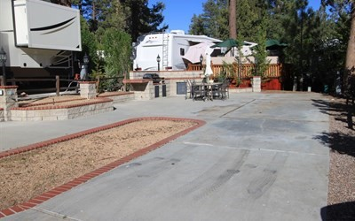 Upgraded RV lot includes coach and offers beautiful block and brick planters, brick topped built in BBQ with sink for your outdoor enjoyment. located within the spectacular lake front community of Big Bear Shores. Big Bear Shores is a gated community that offers beautifully landscaped grounds and a club house with fireplace, full kitchen, TV's, entertainment areas and pool tables. Other amenities include a gym, tennis court, basketball, pickle ball, laundry facility, pool, two spas, restrooms with showers and lockers.