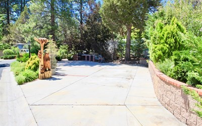 Awesome corner lot with lake views. located within the spectacular lake front community of Big Bear Shores. Big Bear Shores is a gated community that offers beautifully landscaped grounds and a club house with fireplace, full kitchen, TV's, entertainment areas and pool tables. Other amenities include a gym, tennis court, basketball, pickle ball, laundry facility, pool, two spas, restrooms with showers and lockers.