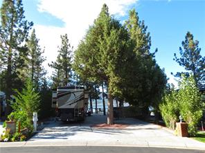 Lake front RV lot with incredible lake and ski slope views! Move in ready lot offers a large storage room under the deck, Glass wind-wall surrounding the lake side of the upper deck, low maintenance Trex type deck with decorative back splash wall includes lots of lighting & outlets. Newer kitchen unit w/ granite countertops, sink, 2 side burners, grill, refrigerator, BBQ & Buffet table. Tall native trees for natural shade, beautiful lawn area below w/ decorative block & brick capped retaining wall, street side landscaping as well. located within the spectacular lake front community of Big Bear Shores. Big Bear Shores is a gated RV community that offers all the refinements of a country club in a forest setting, beautifully landscaped grounds & waterfall entry. A club house, gym, tennis, basketball, pickle ball, private storage locker, laundry facility, pool, two spas, restrooms w/ showers.
