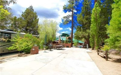 Located within the spectacular lake front community of Big Bear Shores. Big Bear Shores is a gated RV community that offers all the refinements of a country club in a forest setting, beautifully landscaped grounds with mature towering trees a spectacular and waterfall entry. A three story club house with fireplace, commercial kitchen, 2 bars, big screen TV's, entertainment areas and pool tables. Other amenities include a gym/workout room, sports court (tennis, basketball & pickle ball), private storage locker, laundry facility, swimming pool, two spas, restrooms with showers and lockers.