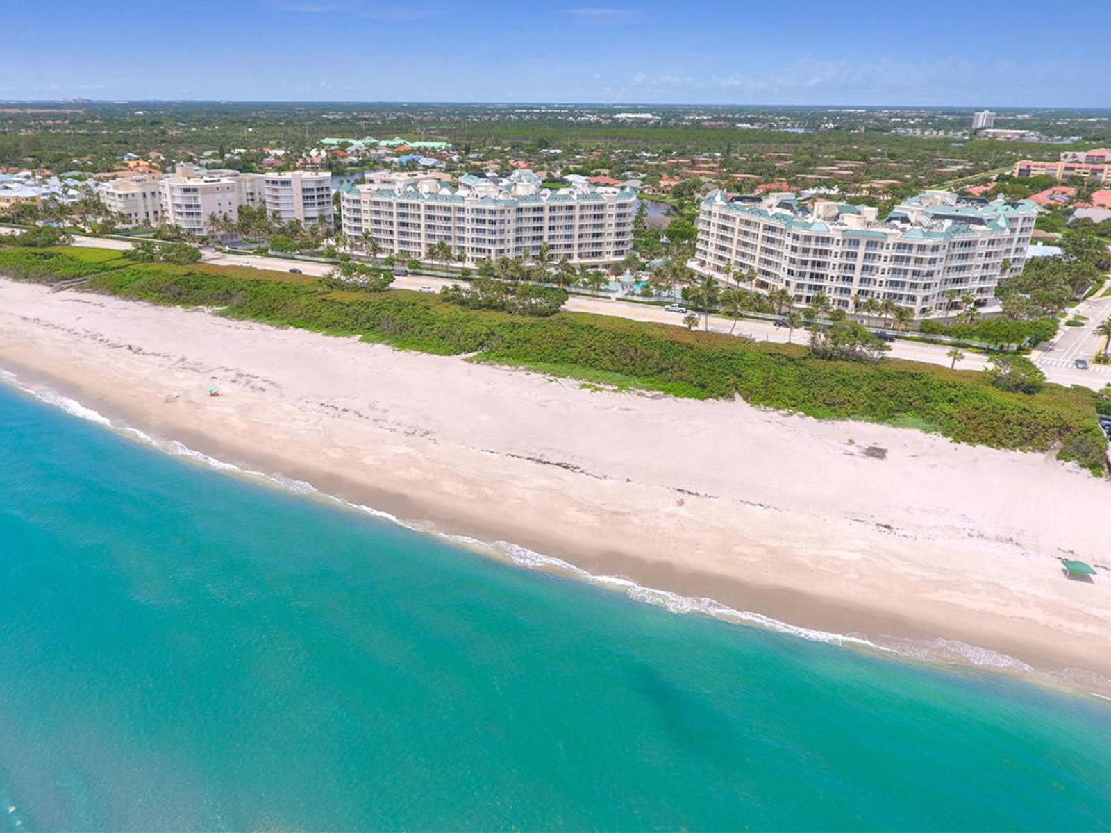 Spectacular 5th floor oceanfront condo located in the highly sought after Jupiter Ocean Grande community. You will be amazed at the endless turquoise blue ocean views from the moment you enter the front door throughout the entire living area & master bedroom. This luxury condo unit is professionally designed with upgrades throughout and features 3 bedrooms, 3 bathrooms, walk in closets, custom window treatments, gorgeous light fixtures, new cabinetry and quarts counter tops in the bathrooms, remarkable kitchen with granite counter tops and stainless steel appliances. This unit is open, bright, and in pristine condition.