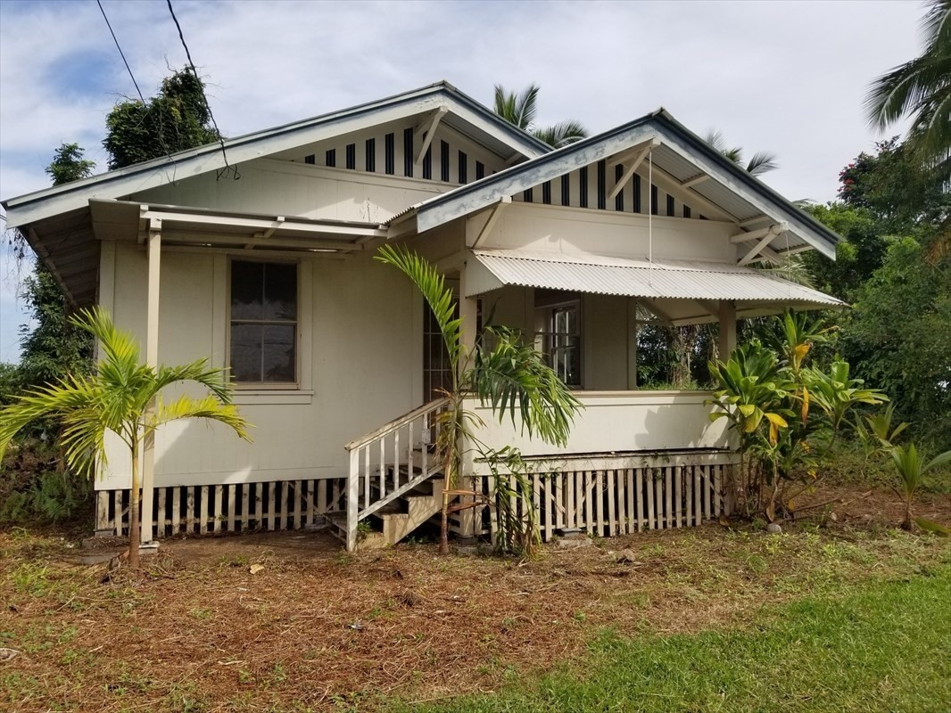 You know what they say, location, location, location! This cute three bedroom, two bath home located on Kawailani Street across from the golf course has it all. The classic plantation style home is tucked back off the road, and you don't have any neighbors right next to you giving the feeling of being in the country with all the convenience of living in beautiful Hilo town.   This is the perfect opportunity to own an old plantation style home with its beauty and character. These types of homes don't last long, so don't wait!