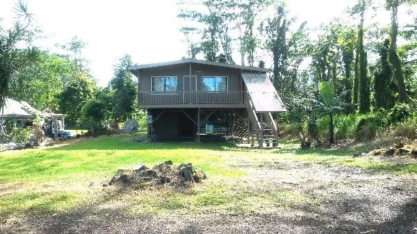 QUIET ~ COOL ~ PRIVATE ~ IMMACULATE 3 bdrm, 1bath, and a large carport. There is also W/D hookup down stairs, beautiful laminate flooring, with a covered lanai. This house is move in ready.   Hwy 30 turn into Ainaloa Drive (m/m7) about 2 miles up the hill turn Right into Paradise Court, between pole 4 & 5 house will be on the left side.