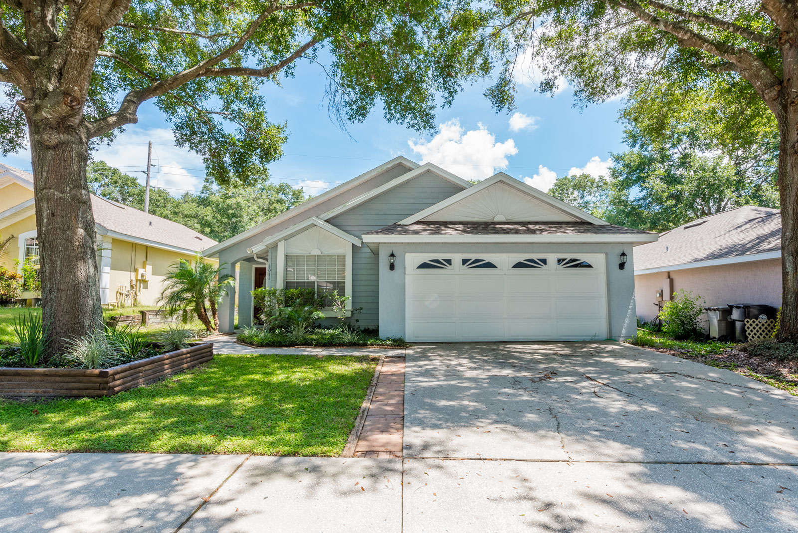 Live near the best Apopka has to offer! Your new home is located in a serene community with **LOW HOA** fees. This move-in ready home showcases an **UPDATED KITCHEN**, TILE & WOOD LAMINATE FLOORS, VAULTED CEILINGS, and more. Don't miss out on what could be YOUR home!