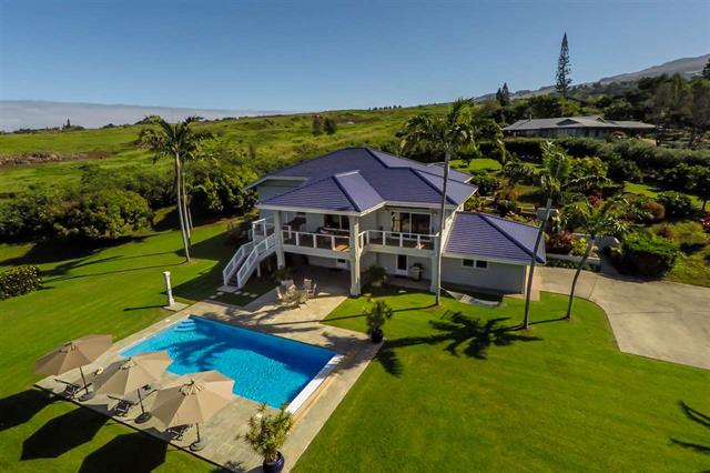 Ideally located on the gentle slopes of Haleakala in the sought after neighborhood of Kula Glen, 1044 Holopuni offers a private retreat blessed with great views of the neighboring islands, West Maui Mountains, and both coastlines of the island of Maui. Resting on 2 manicured acres with many varieties of citrus, avocados, bananas and a collection of rare Hibiscus flowers dot the walkable grounds. Built for longevity, the concrete construction with a stucco finish is crowned with a custom glazed blue tile roof. Three ensuite bedrooms and a half bath are appointed with the finest of finishes. The great room area and kitchen spaces are adorned with local and exotic woods stretching from the floors to the countertops to the amazing ceiling inserts. Heating and air conditioning are not required in the lower Kula climate which is boasted by many as ideal for year round comfort. This home is a must see!