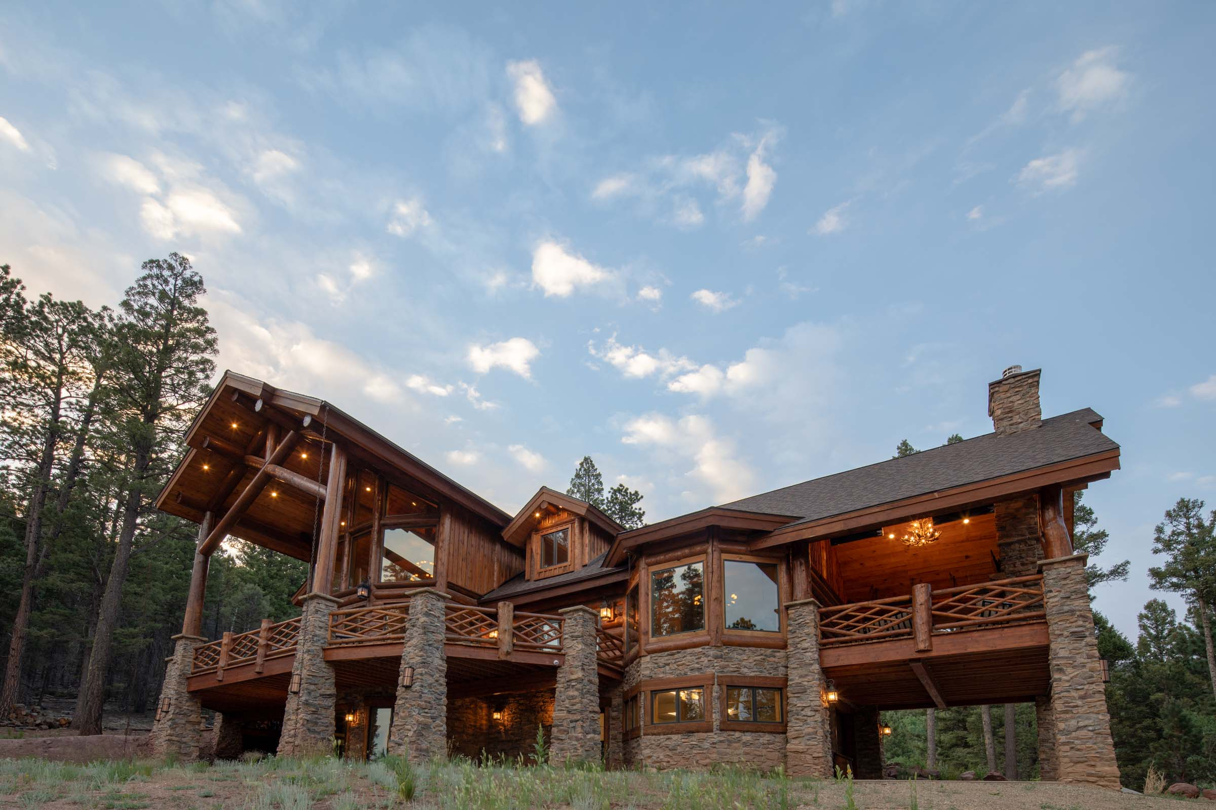 """People's Choice Award"" winner of the 2015 Homebuilder's Parade of Homes.  Gorgeous 15"" Swedish Cope style custom log home with handcrafted log accents set on 10+ acres bordering the Ski Area with Wheeler Peak views and Ski Mountain views.  Grand stone column piers, log truss work and railing with unique designs, spacious outdoor living area/deck with kitchen, exterior heaters, television, stone fireplace and views all around.  Chef's kitchen with high-end appliances, granite and extras.  Lower level bunk room, living/game area and ski lockers off over-sized two car garage.  Grand great room with artisan chandeliers, stone fireplace and large windows.  Lots of outdoor living areas, fire pit with flagstone patio off lower level and large decks above including hot tub off master.  Master bedroom features handcrafted posts, large walk-in closet and private master bath with copper tub.  Ski deck close to property line that is adjacent to ski area.  Home has remote control Insteon lighting system that controls all lights remotely and HEOS sound system that can be activated from a smart phone."