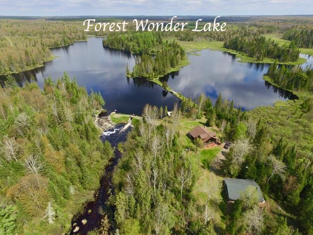 This exclusive lake retreat and acreage, known as Forest Wonder, offers the ultimate privacy and tranquility for the outdoor enthusiast. The amazing 342-acre wildlife sanctuary has moose, wolves, bears, bobcats and lynx. You will also see Swans that return year after year in addition to other migrating birds. Home features 2 BR 2 BA with beautiful pine accent and cathedral ceilings throughout. There is a very deep 2 car garage for storing all your toys and boats.This property offers its own 60-acre lake with additional ponds and has a dam that is registered as a low risk with a rock spillway, which creates a continuous sound of cascading water that can be heard from your 1,550 sqft fully equipped year-round lodge. Current owner has stocked the lake with walleye and pan fish for the past 4 years. Other species found here include northern pike & bass. Don't miss the incredible opportunity to own this piece of paradise.