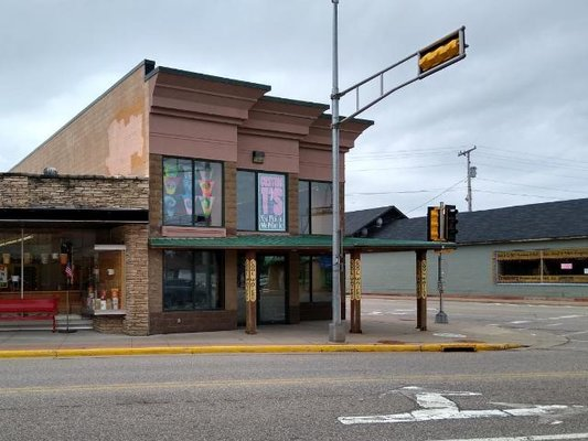WALL ST/DOWNTOWN EAGLE RIVER COMMERCIAL BUILDING - It was a retail store, but there are endless other uses for this newer building in Eagle River. The location is on a corner for terrific visibility and easy access. The interior ceiling is sky high and the large store front windows span Wall Street and Railroad Street. Eagle River is one of the busiest tourist towns in our Northwoods and this is a prime location to attract visitors. The business had been very successful for over 20 yrs. and could be again with new owners. Opportunity plus. Everything is in great condition. Air conditioned too. Come see!