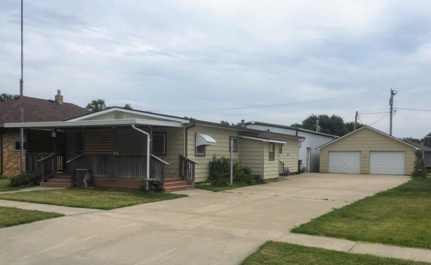Exclusively Listed! Best of both country and city living with this well kept 3 bedroom 2.5 bath manufactured home. Man cave for him with attached mechanic shop & a double detached garage for her not to forget the jet-sit-in bath!