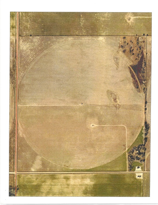 Good pivot irrigated sandy land quarter. Surface rights only. Consisting of 154+ acres. Valley irrigation system covering 119+ acres circle, Cummins diesel engine and all supporting equipment. Water File #39890 with 174 acre feet @ 825 gallons per minute. (Currently pumping 700 to 725 gallons per minute) FSA Information: 31.22 Acre Wheat Base, 47.23 Acre Corn Base, 62.45 Acre Soybean Base. 119+ Irrigated acres 21.62+ dry land acres, 13.38+ acres of trees, grass & waste. Livestock well.