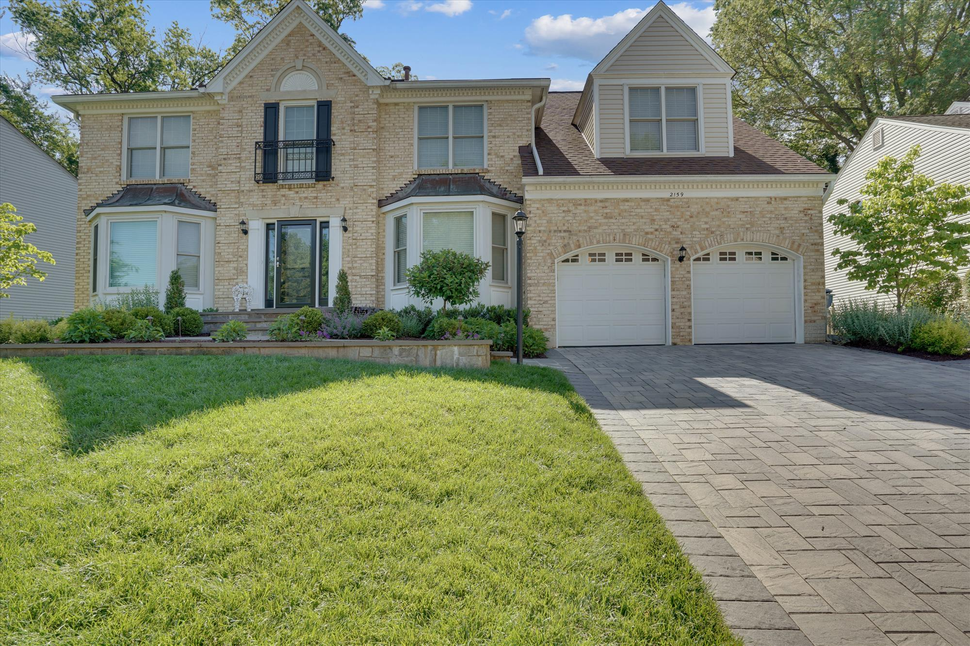 """Amazing opportunity to buy a completely turn key Vienna single family home that checks all of the boxes! Renovated in 2016 inside, plus a $300k exterior renovation that includes a 3-season huge screened-in-porch, patio with fire pit, hot tub, built-in gas grill, and a natural gas generator. Inside the home, you'll find a sunlit main level with hardwood floors that flow through the foyer, formal living room, office, huge dining room, large kitchen with island, white cabinets, granite counters, stainless steel appliances and gas cooking. The eat-in kitchen overlooks a large vaulted family room with skylights, luxury vinyl flooring, and wood burning fireplace. The mud room has space for cubbies/hooks, the washer/dryer, and a side entrance to a fully fenced space of the yard. The 2-car garage actually fits both cars and storage. Upstairs, you'll find a large primary bedroom with multiple closets, recessed lighting, vaulted ceiling, a sitting area, a dressing area, plus a renovated bathroom with glass enclosed shower, tub, and dual vanity. Each of the 3 secondary bedrooms have Elfa shelving in the large closets, and each has an en-suite bath with tub - all have been renovated! The basement is entirely finished and carpeted, which offers 2 lower level """"rooms"""" currently used as guest rooms, with another fully renovated bathroom. There's a large rec room and a large game room/media room. So much space! The owners have done a LOT of updating, including: Front Door Replaced 2021, Attic HVAC 2019, patio/hut tub/fire pit 2019, French Doors on Office/Living Room 2019, driveway pavers 2018, screened in porch 2017, Water Heater 2017, 2015 Roof, Irrigation System, electric collar fence. HOA offers block parties and snow removal."""
