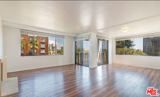 This is a polished 2 bed + 2 bath, single-level condo North of Wilshire, just steps to the Promenade. Enter thru a gracious foyer that opens to a large living room / dining room with gas fireplace and tons of natural light. Living / dining on South & East corner with lots of sky, treetop and city views. Nice-sized balcony on south east corner, perfect for BBQ'ing. Sophisticated galley kitchen with stainless steel appliances, breakfast nook, and laundry closet with stacked washer/dryer. Spacious master suite with large walk-in closet. Master bath with double vanity and stand-alone shower and separate tub. Wood-style flooring throughout. Includes two, side-by-side parking spots in the community, subterranean, gated garage. The building amenities include a pool, spa area, fitness room, and club room. Great opportunity to own a fantastic unit in a marvelous location.