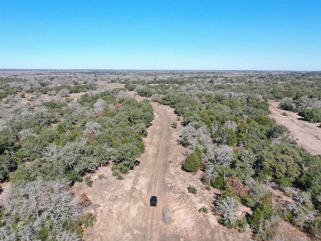 The K Bar Ranch is a 965 +/- contiguous acre spread located approximately 1.5 hours from Austin, Houston and San Antonio. It's a rare opportunity to acquire almost 1,000 acres instantly. Located 6 miles south of Hallettsville off paved FM 2616, you'll have quick access to groceries, restaurants and medical needs, while still enjoying the peace and serenity of nature. The ranch features cattle pens, a century old farmhouse, RV hookup, and tons of wildlife - including deer, wild hogs, turkey and bobcats. Multiple parcels form a rectangular shape so it could be an ideal hunting or exotics ranch. Electricity, water wells and septic tank are in place. Additional water is available from a couple of ponds, and the creek has running water after nice rains. It's not often that a property of this size becomes available. So here is your chance to take advantage of this large canvas, fulfill your dreams, and make it your own!