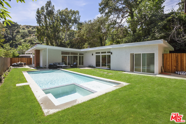 Nestled in the coveted enclave of the Wonderland school district, this stunningly remodeled 4 bedroom/4 bathroom home is an architectural mid-century modern retreat. Some of the many upgrades include: new copper plumbing, new electrical wiring/panel, tankless water heater, new duel HVAC system with NEST thermostats, new gas line, new Milgard sliding doors and windows, new hardwood flooring and Terazzo tile, new chef's kitchen with custom cabinets and Thermador appliances, recessed lighting installed throughout the home, spa-style bathroom upgrades, and a newly installed saltwater pool/spa, secluded by lush green landscaping. Each room in the house was thoughtfully remolded and reimagined to make this home the epitome of California living at its best.