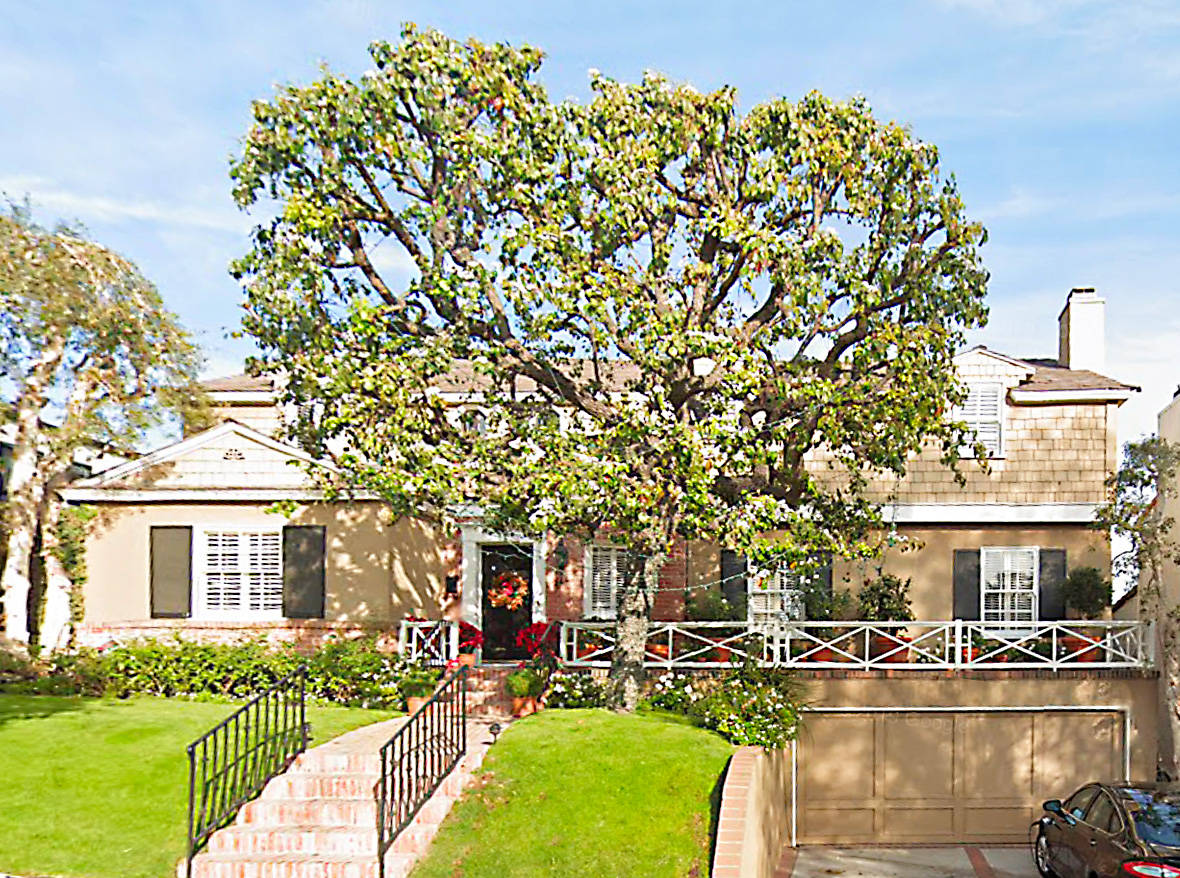 Westwood Hills traditional. Spectacular yet serene views. Designer owned & done. Hardwood floors thruout. Updated kitchen w/ tThermador ovens and Sub-Zero frig. Redone baths w/ travertine floors, vanity & dressing area. Backyard garden with deck. Wonderful curb appeal. Direct access garage. Warner Ave elem.