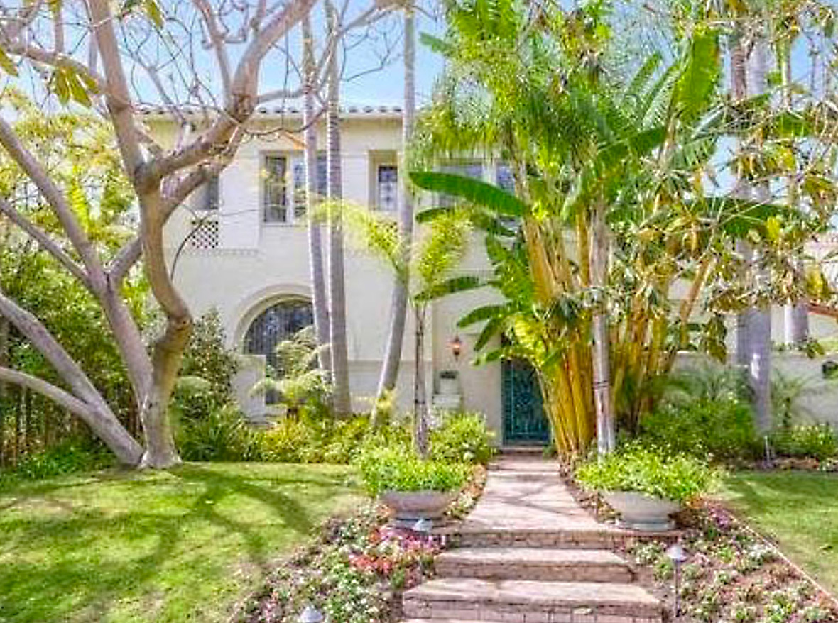 $200,000 Price reduction! Client has their bags packed & is motivated! Lovingly restored 2-story mediterranean conjures up romantic charm! Large tropical palms & fountain lead to a 2-story foyer complete with wrought-iron staircase, stencil detailing, exquisite molding, wood floors & french doors reminiscent of a bygone era. Soft arches, hand-painted frescos, dramatic leaded glass, mahogany doors, & original tile work add to the european feel. Spacious dining & living rms open to loggia w/fountain. Cleverly designed for indoor/outdoor flow, the gourmet kitchen cozies up to a warm family rm. Junior dining rm replete with sublime 'wedding cake' plasterwork & hand-carved doors leads to the terrace with a huge rock waterfall spa for 20, outdoor fireplace & multiple areas for entertainment. Inside, luxury abounds with 3 bedrooms that form private retreats, a comfy study w/ fireplace and vaulted ceilings. Private & gated, this little holmby abode with double garage offers serenity galore.