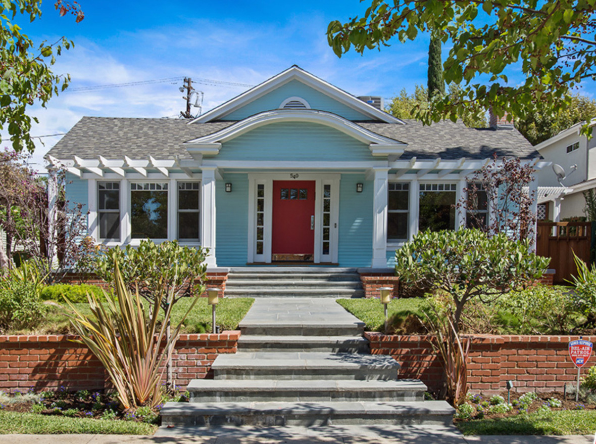 Set back from the street this classic Craftsman w/coveted porch sits on a quiet street, just minutes from desirable Larchmont Village. Preserved period details; built-ins & wide base & crown moldings. Recessed lights & hardwood floors throughout. Timeless built-ins flank the fireplace. Original built-in buffet in dining room. Chef's kitchen w/eat-in breakfast area that overlooks the garden is complete w/marble counters, custom wood cabinets & professional series freestanding Wolf cook top w/9 burners, griddle & massive hood. Master w/vintage detailed en-suite bath, 2 large walk-in closets & built-in drawers. Generous 2nd bedroom w/built-in shelving. Renovated 2nd bathroom w/big stand-alone shower. 3rd bedroom has interior French doors, currently being used as an office. Laundry in closet. Vintage style double hung windows & air conditioning throughout. Private backyard with dipping pool, spa, patio & a fabulous separate office retreat w/built-in desk shelving. This gem won't last!