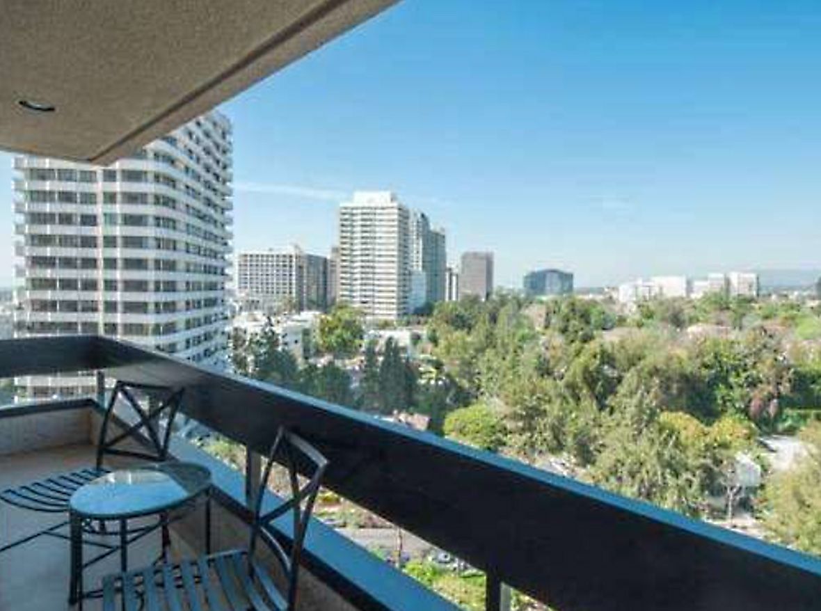 Special opportunity! Jetliner Views from this rear facing, 11th floor, 2 bed, 2.5 bath unit in The Wilshire Corridor's desirable Regency Wilshire. Bright & open with walls of glass in 2,097 sq ft! Stunning new Maple hardwood floors & recessed lighting throughout. Living room with gas fireplace, wet bar and large balcony overlooking Little Holmby, UCLA & Bel Air. Huge cooks kitchen with adjoining breakfast area. Large airy master bedroom suite, complete with an expansive wall of windows, forever views & two large walk-in closets with built-ins. Sizeable corner 2nd Bedroom suite with north and west views. Laundry room & loads of storage. Full service bldg. with 24 hour valet & security, recreation room, gym & pool.